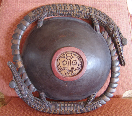 Bottom of carved serving bowl (Papua New Guinea)