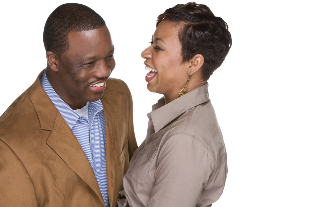Engagement Portrait of Couple Laughing on White Background by Lamonte G Photography Baltimore