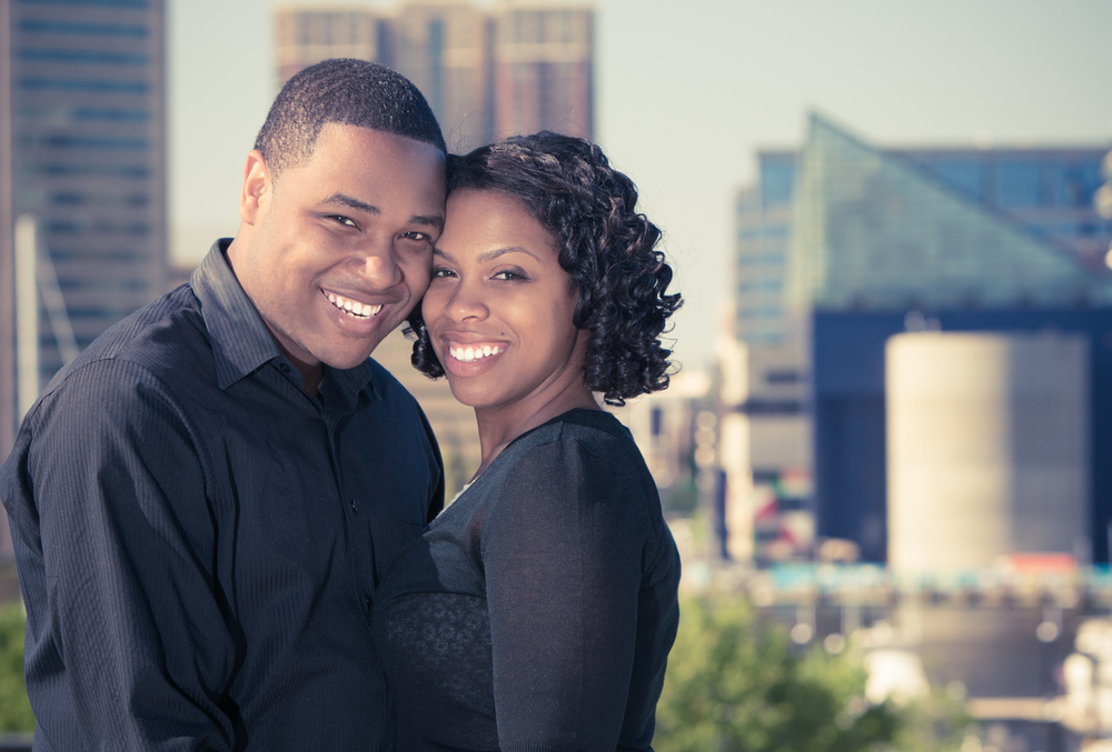 Engagement Portrait of Couple Overlooking Baltimore Inner Harbor by Lamonte G Photography