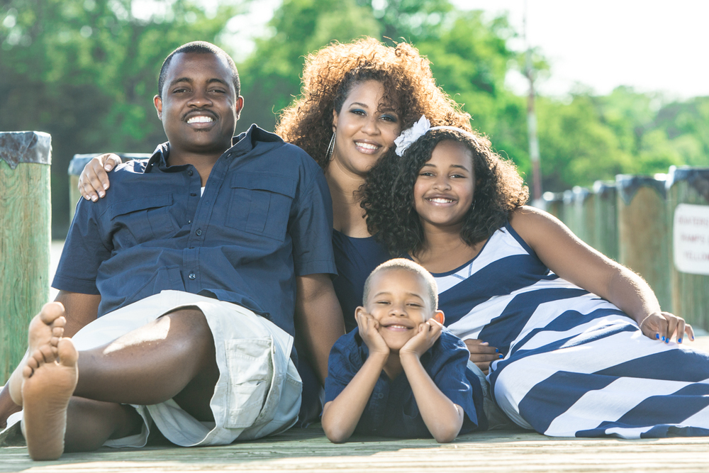 Family Portrait Outside on Pier at Beach by Lamonte G Photography Orlando