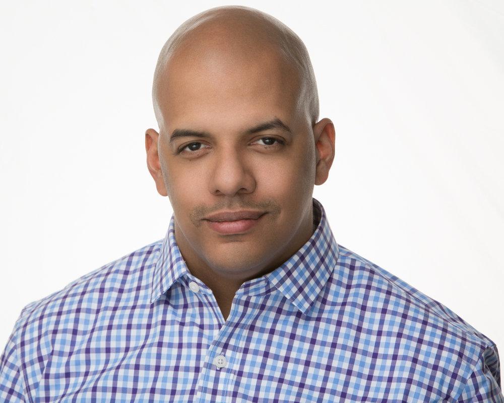 Argin Hutchins Audio Headshot in Baltimore Blue Shirt