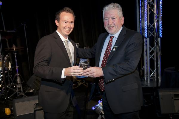 Scott Barbour, QSR Team Manager, Americold Logistics (QLD), 2013 Frank Vale Award Winner, receiving his Award from Martin Porter, MD Retracom Group, sponsor of the international travel prize.
