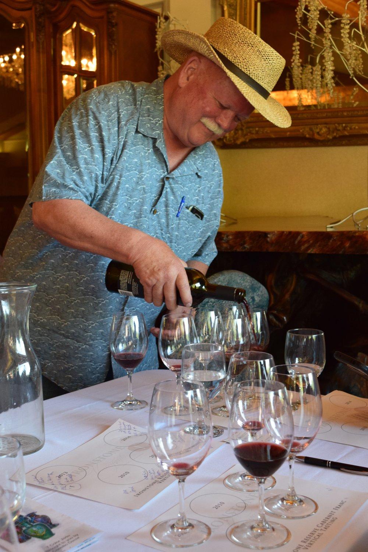 Winemaker Steve Millier pouring Cabernet Franc.