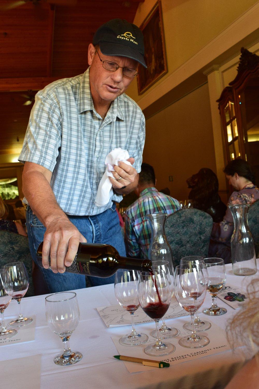 Winemaker Craig Rous pouring Cab Franc