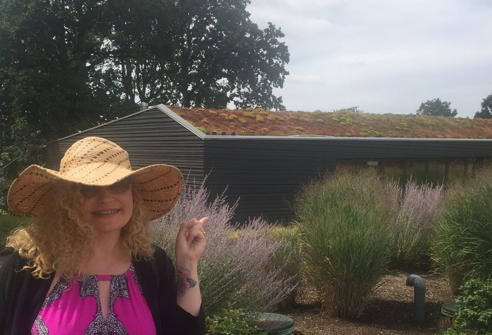 """Moi, pointing to the """"green roof"""" at Sokol Blosser. Photo by Gabriel Manzo."""