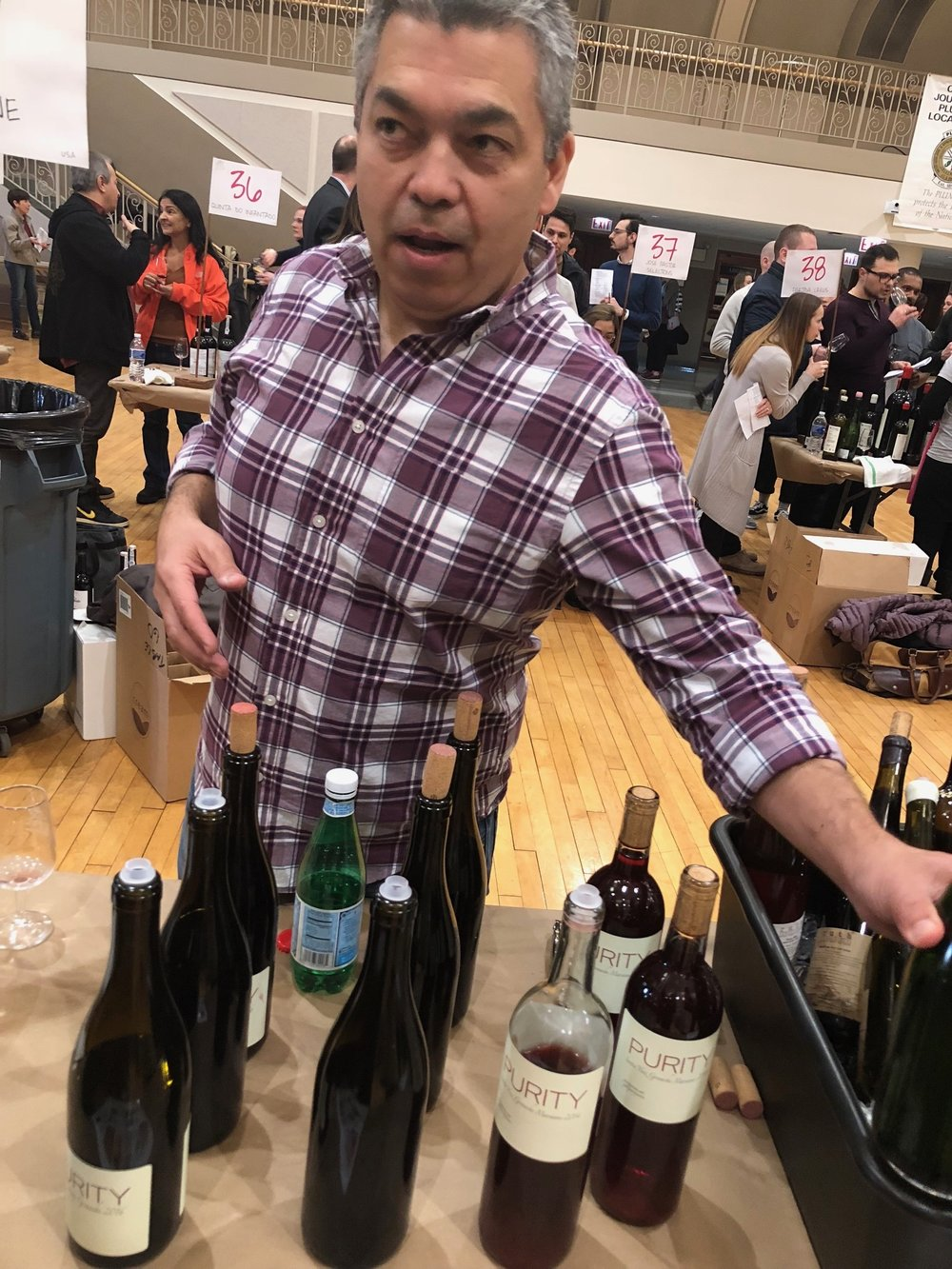 Purity Wine - Based in Northern California, Noel Diaz pouring wine at Third Coast Soif, Chicago, March 2018, makes a rosé of Mourvedre, Pinot Gris, Syrah, Barbera and Mourvedre from  a few different vineyards. He sources from an abundance of vineyards primarily from Calaveras County in The Sierra Foothills, and makes his wine at a space in Richmond, CA.
