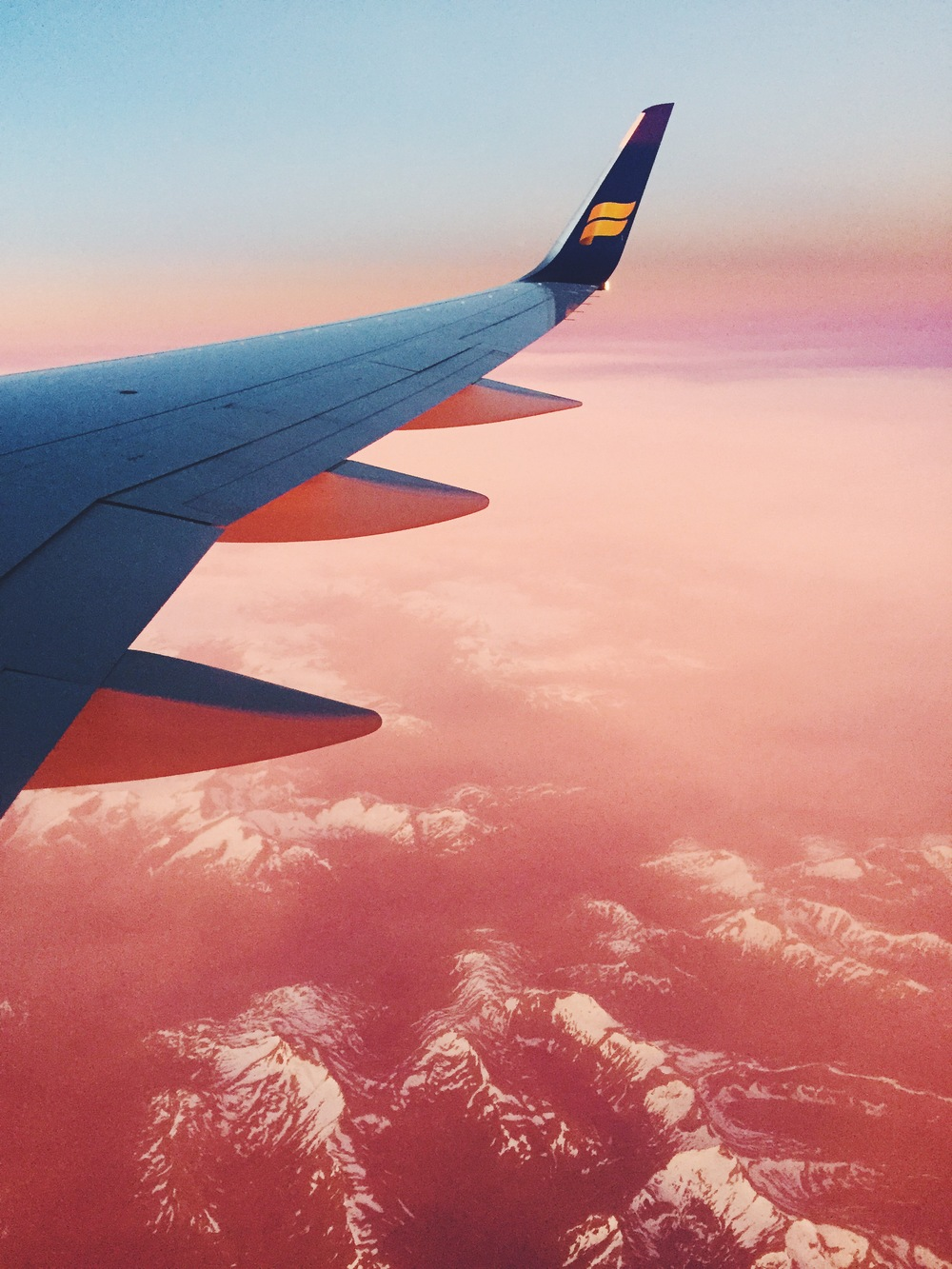 I woke up from a nap on my flight from Iceland to Sweden to the sun rising. The sun was on the other side of the plane, but it turned everything this hazy pink color. This was also my first view of Sweden.