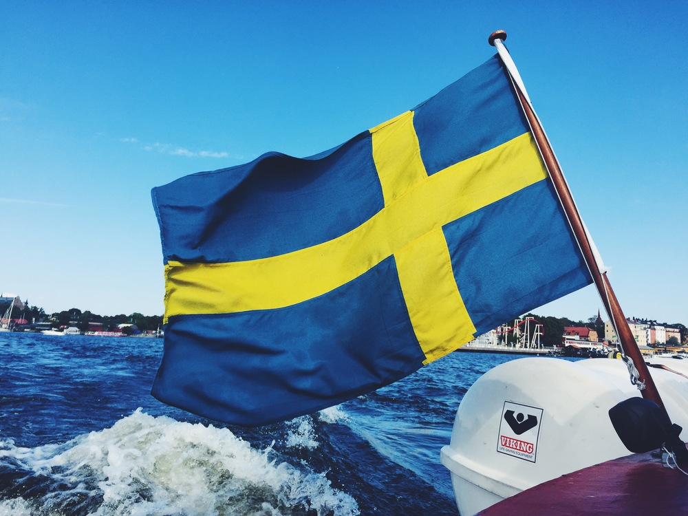 "The Swedish flag hoisted on the back of our ""Hop On Hop Off"" boat tour around Stockholm."