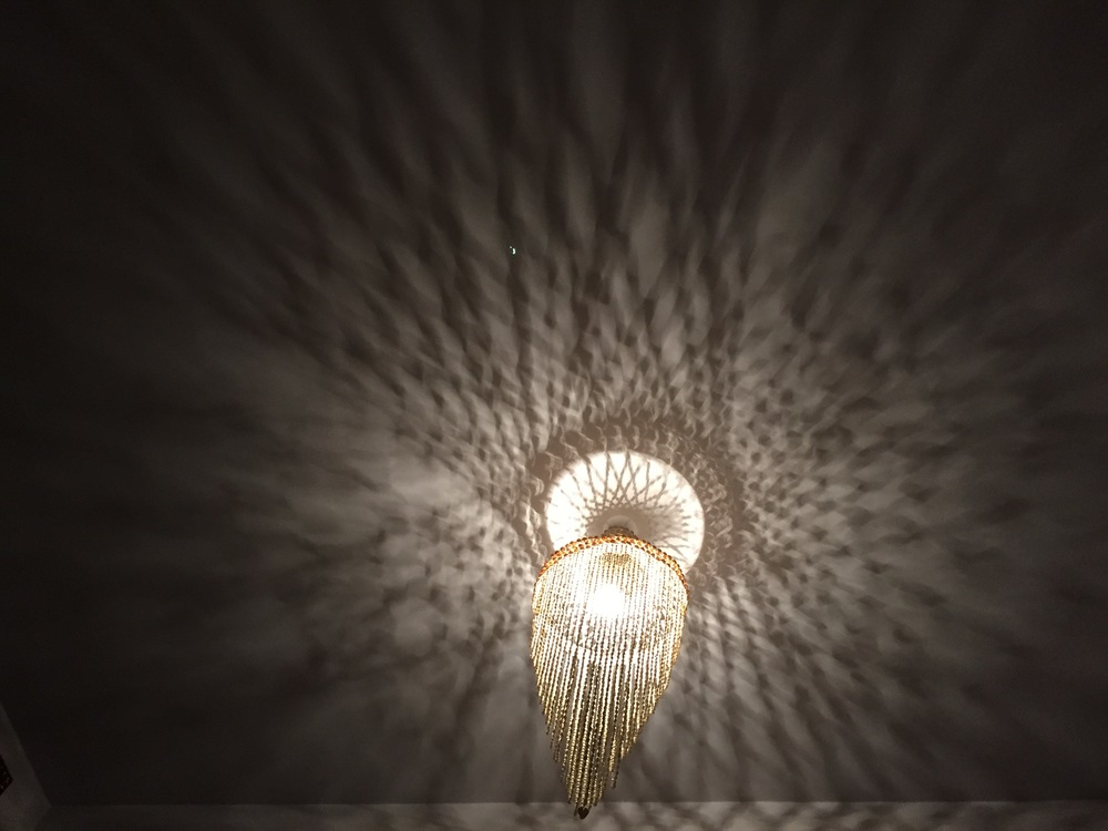 The chandelier hanging above our bed at our Airbnb in Milan, Italy.