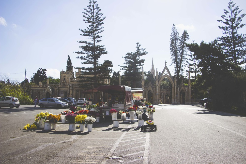 Locals sell flowers outside the Malta (Capuccini) Naval Cemetery.
