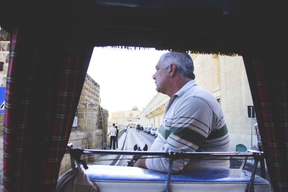 Our guide, Charlie, showing us around Valletta via horse-drawn carriage.