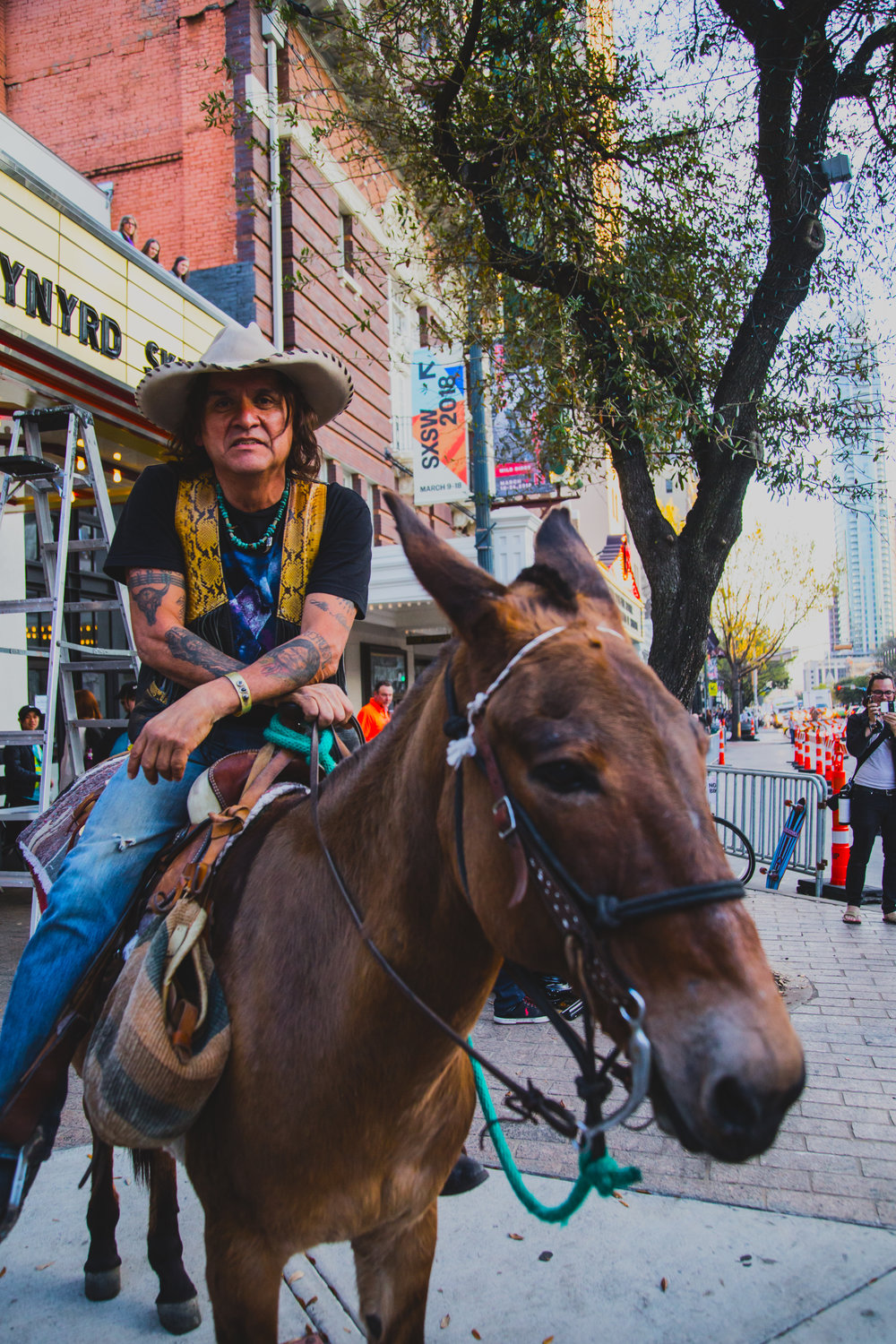 Sam Olivo, the Sixth Street Cowboy, hanging out in front of the Stateside Theater on 03.13.2018
