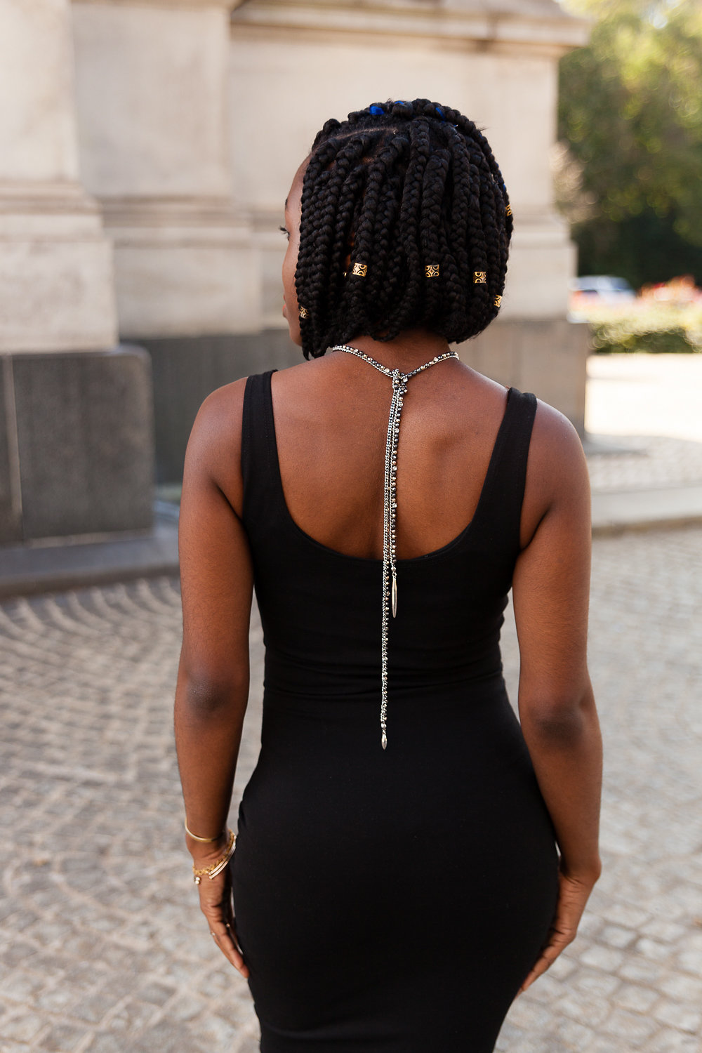 The Back Tie - For a sexy look with a low back, create a loop knot similar to the simple knot shown above and swing the necklace towards the back.