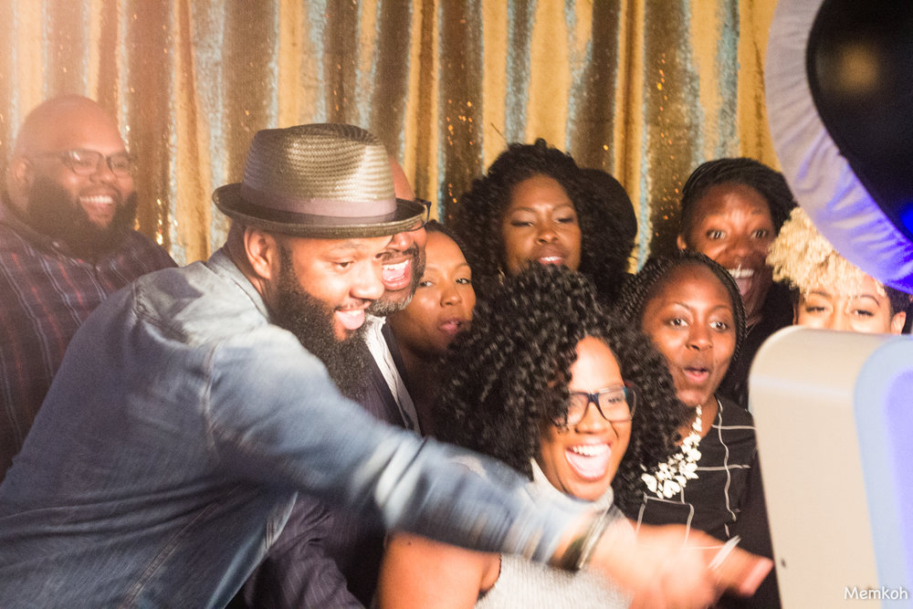 Love this blurry yet perfect shot of some guests at the photobooth