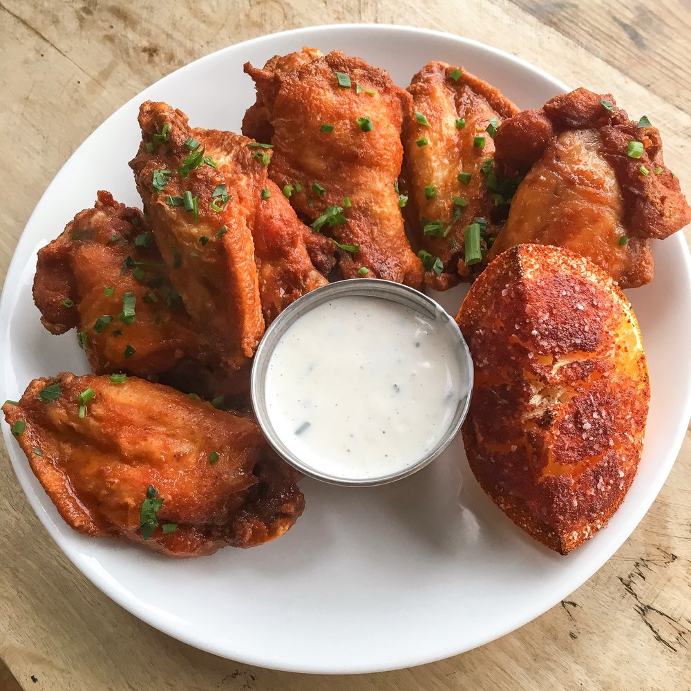 Every Monday Night   $1 wings and $1 select cans of beer