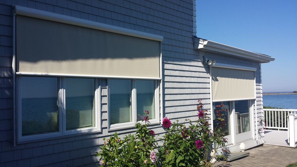 Solar shades to block out the sun at certain times of day, can also look stylish and fit in well with a homes design. These were installed by Betterliving Sunrooms of NH in Kittery, Maine.