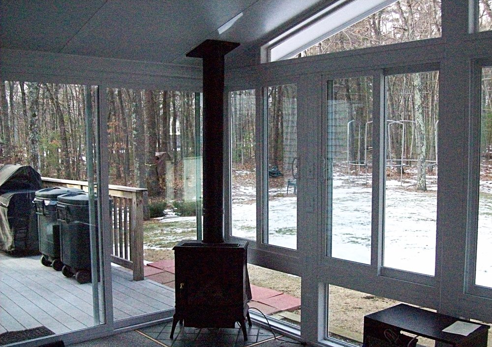 woodstove in sunroom
