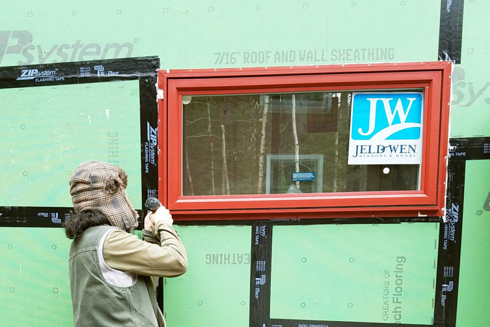 Bob installs a new, red vinyl Jeld-Wen window in the  8x18 Whirly House