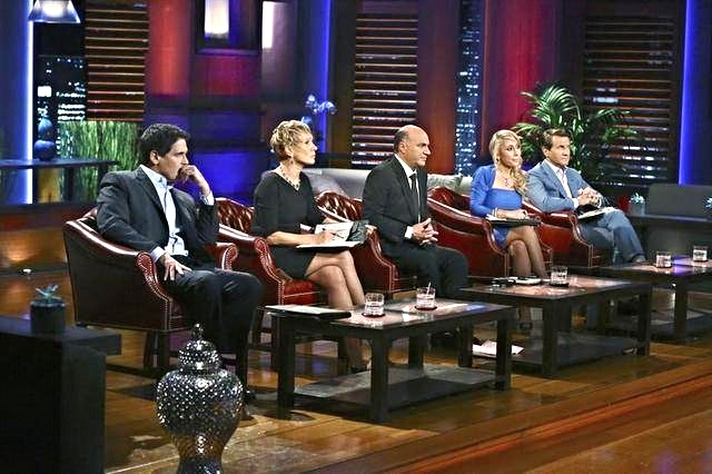 Imagine selling to this group of Sharks. What do you think their body language says about the sales pitch they are listening to?(Image from NBC's Shark Tank)