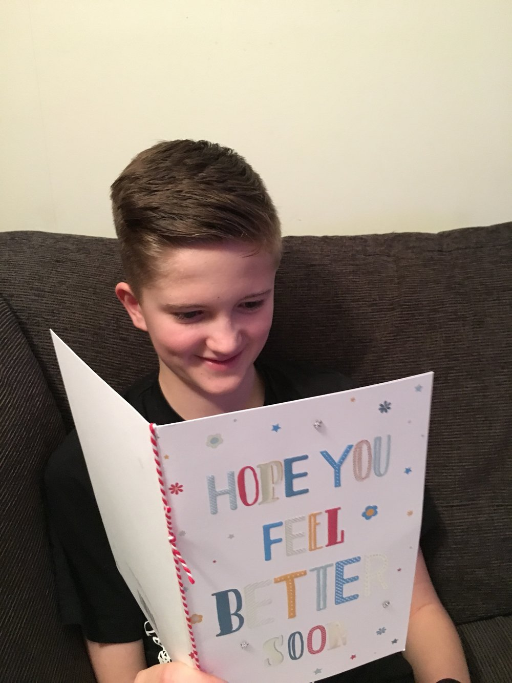 Sam receiving a morale boosting get well soon card from all at Pershore Tennis Centre and Pershore futures squad