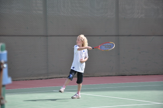 My first time on a tenniscourt, when I was 8 years old - not a big success.