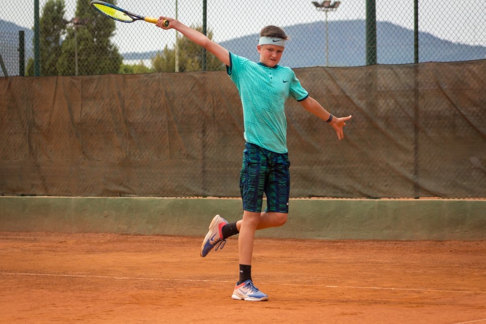 Sam working on his one handed backhand.