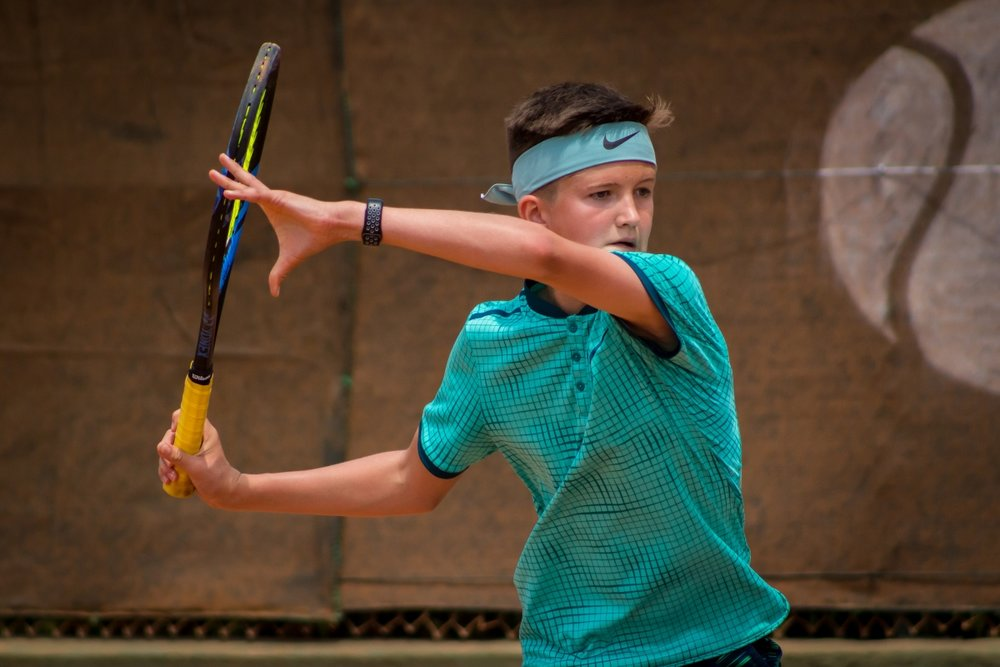 Sam in action at Barcelona Tennis Academy.