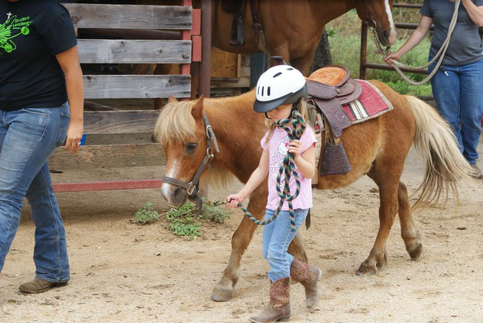 Little Horse camper with her pony