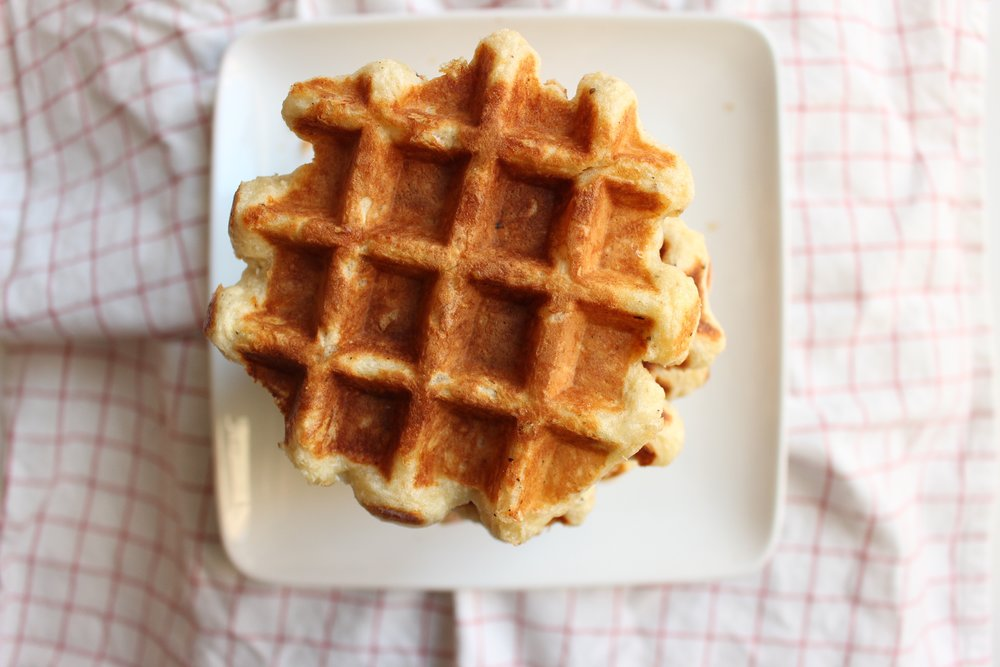 Tomato soup and cheese waffles | Me & The Moose. Winter weather means tomato soup and grilled cheese, so switch it up for your next snow day with cheese waffles. Also, you can skip the dairy and still make a creamy tomato soup if dairy isn't your thing. #meandthemoose #tomatosoup #cheesewaffles #wafflerecipes #souprecipes #dairyfreesoup #lunchrecipes