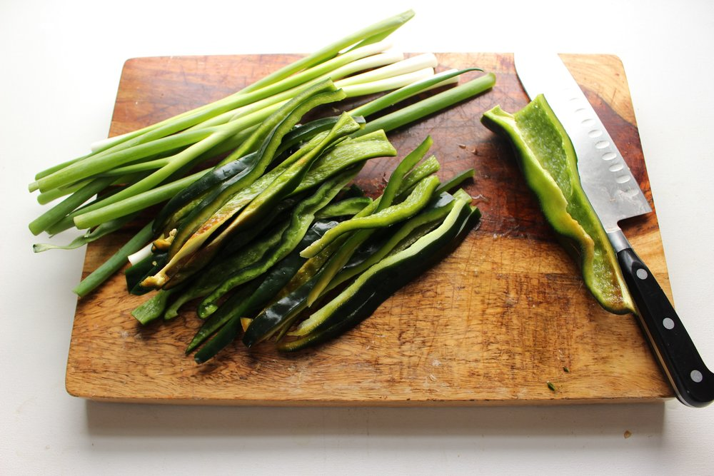 Fresh poblano peppers and scallions mellow considerably when roasted.