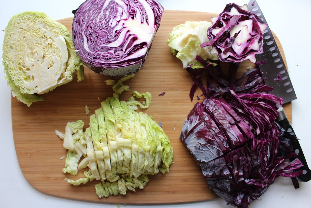 Green and red cabbage are perfect for roasting with fish because they cook fast and get both melty and crispy.