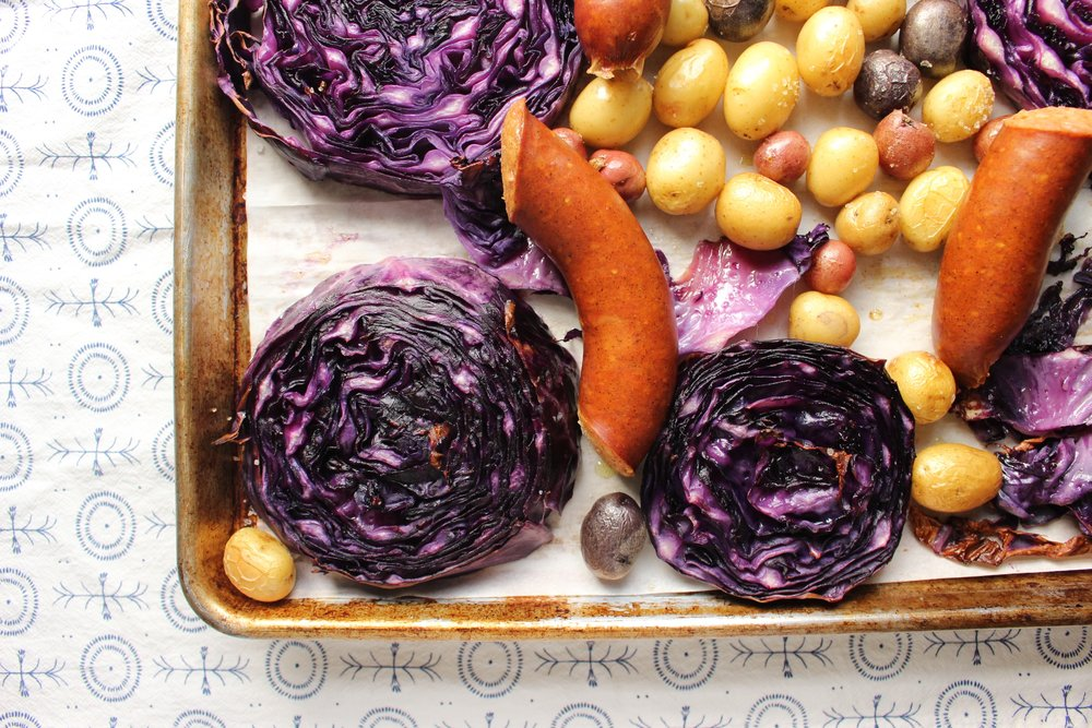 Sheet pan dinners are the easiest way to get dinner on (and off) the table. Purple cabbage, potatoes, and chicken or turkey sausage combine for a universally appealing dinner. #meandthemoose #sheetpandinner #purplecabbage #potatoes #sausage #Oktoberfest