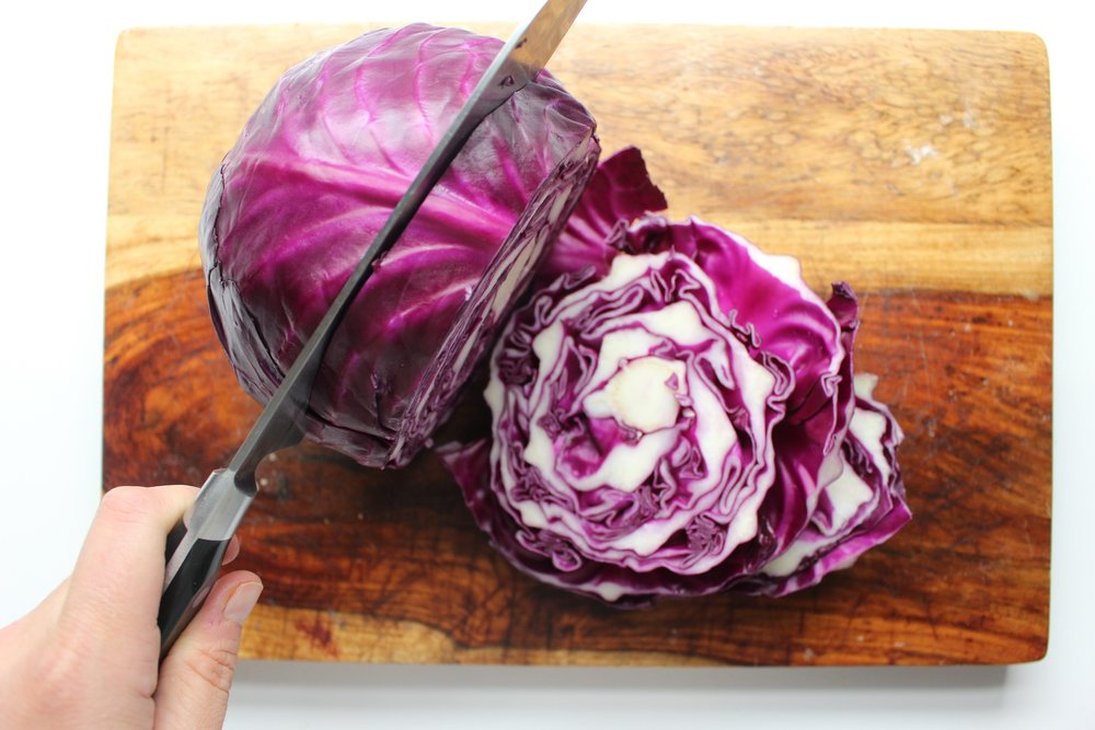 Thick cuts of cabbage lead to crispy edges and softer interiors. #meandthemoose #sheetpandinner #purplecabbage #potatoes #sausage #Oktoberfest