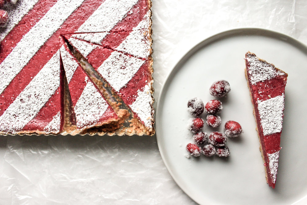 Cranberry bars | Me & The Moose. These simple cranberry bars are a showstopper that looks complicated, but is actually easy to bake ahead and cut up for cookie swaps, office holiday parties, and your cookie tray. #cranberrybars #christmasbaking #lemonbars #meandthemoose #holidaydesserts #batchbaking