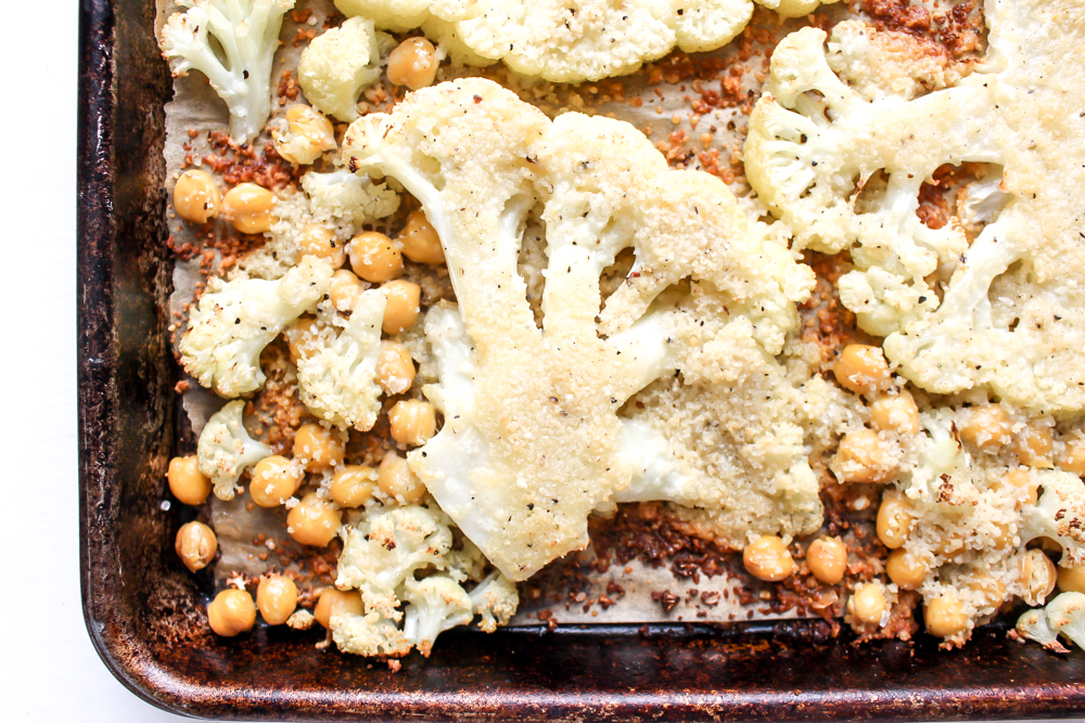 Cacio e pepe cauliflower and chickpeas | Me & The Moose. This vegetarian sheetpan dish hits all the right notes of cheesy, creamy, crunchy, and delicious. It's filled with protein and appealing to vegetarians and carnivores alike. #meandthemoose #sheetpanmeals #vegetarianrecipes #cauliflower #cheese #cacioepepe #chickpeas #vegetarian #vegetariandinners