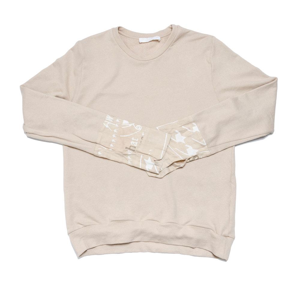 beige knit sweatshirt with printed linen cuff