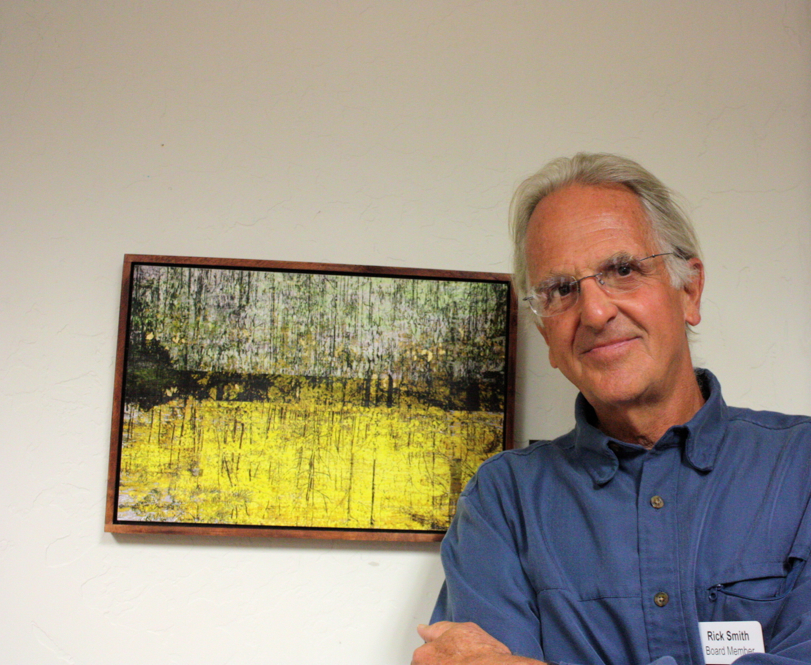 Rick Smith with his painting, Autumn & Eve: Gray's Creek. Photo by Cynda Green