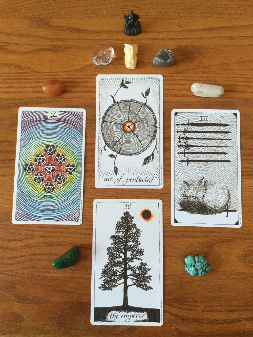 The cards, friends, and allies. From the top: Ganesha, Owl, Beach Agate, Crystal Quartz, Turquoise, Green Chalcedony, Carnelian, Clear Quartz.