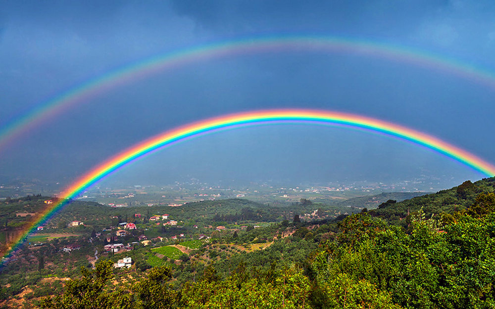 """In Chinese culture red is symbolic of the feet and violet represents the head. So a Primary Rainbow can be seen to illustrate a human descending from heaven. As stated before, the secondary arc in a Double Rainbow has reversed colors so, since the red is on the bottom and the violet is on top, the human figure is ascending from the material earth to the spiritual heaven. Therefore seeing a Double Rainbow is considered a very auspicious occasion and a reason for reflection and meditation."""