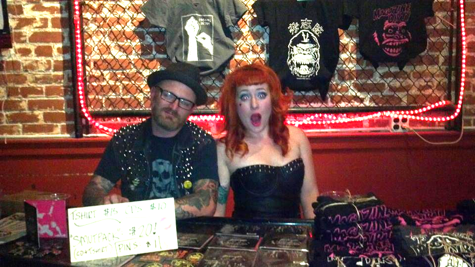 Selling merch with my love, Reid, ( aka Dr. Cain) after a SLO Brew set.