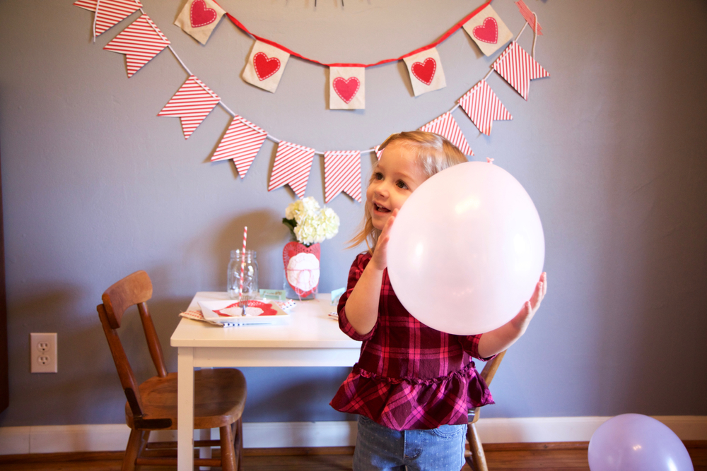 I've decided that I could easily rid my home of all toys if I just commit to blowing up one balloon a day. The joy she gets from a simple balloon is unreal.