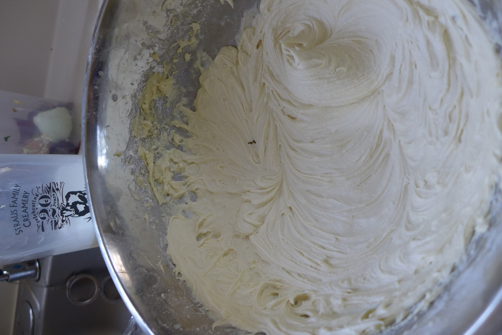 Milk is key to loosening up the frosting to a fluffy, very spreadable consistency.