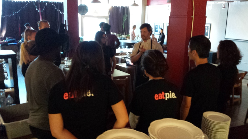 Chef David prepping staff and volunteers to deliver a 4 course benefit dinner in 2015.
