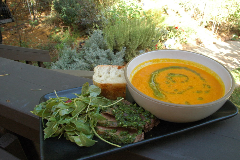 Carrot soup with parsley oil, chimichurri steak and arugula salad