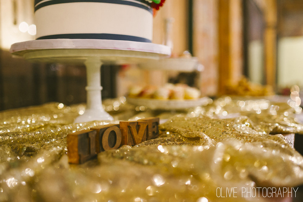 Gold sequin table cloth and letterpress blocks Photo by Olive Photography