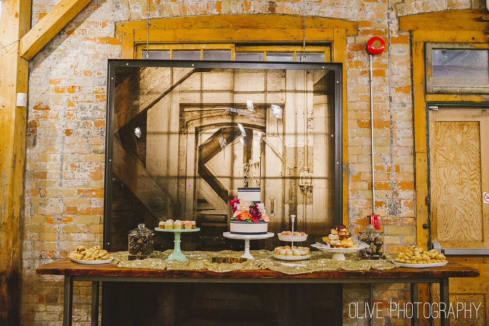 Gold sequin table cloth and cookie jars Photo by   Olive Photography