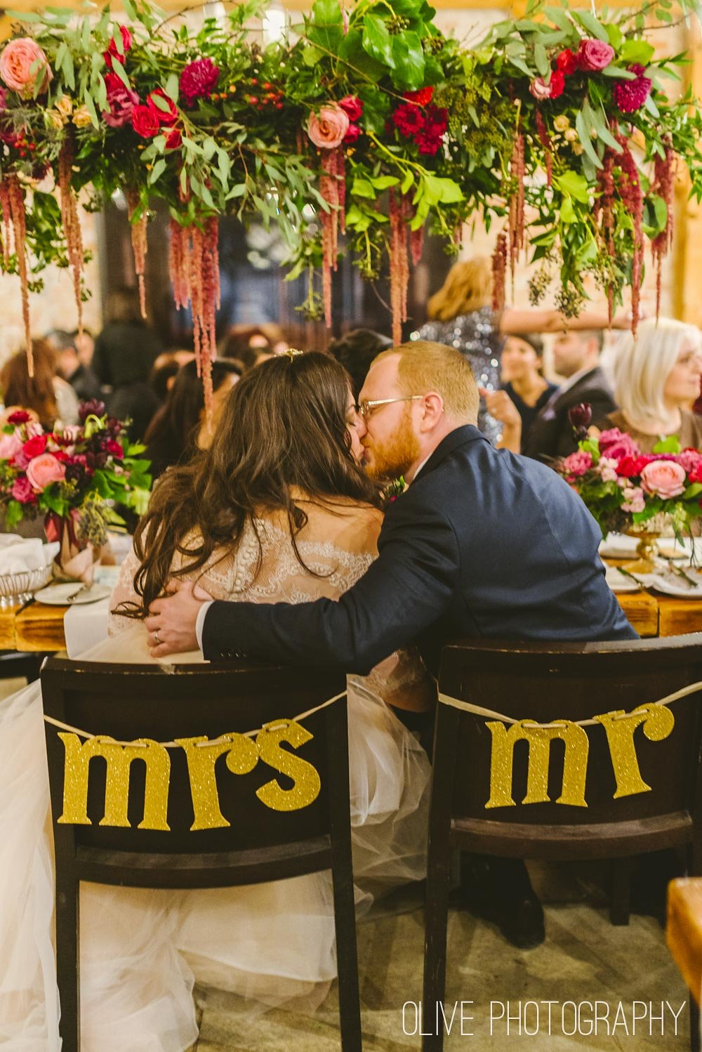 Gold glitter Mr and Mrs chair signs Photo by Olive Photography