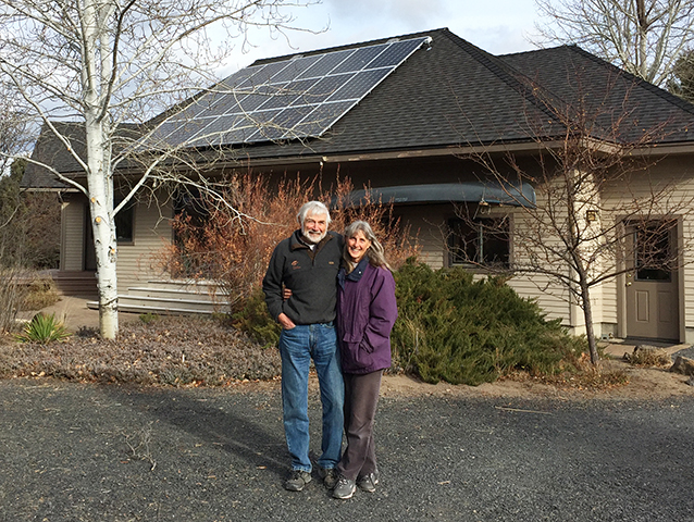 Proud E2 Solar customers with their new solar installation.