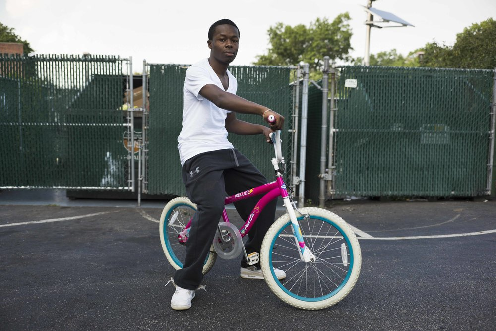 Khalif Ritchards 18, borrows his younger sister's bike to ride across East Orange, New Jersey, once a week to check in at the recruiting station.