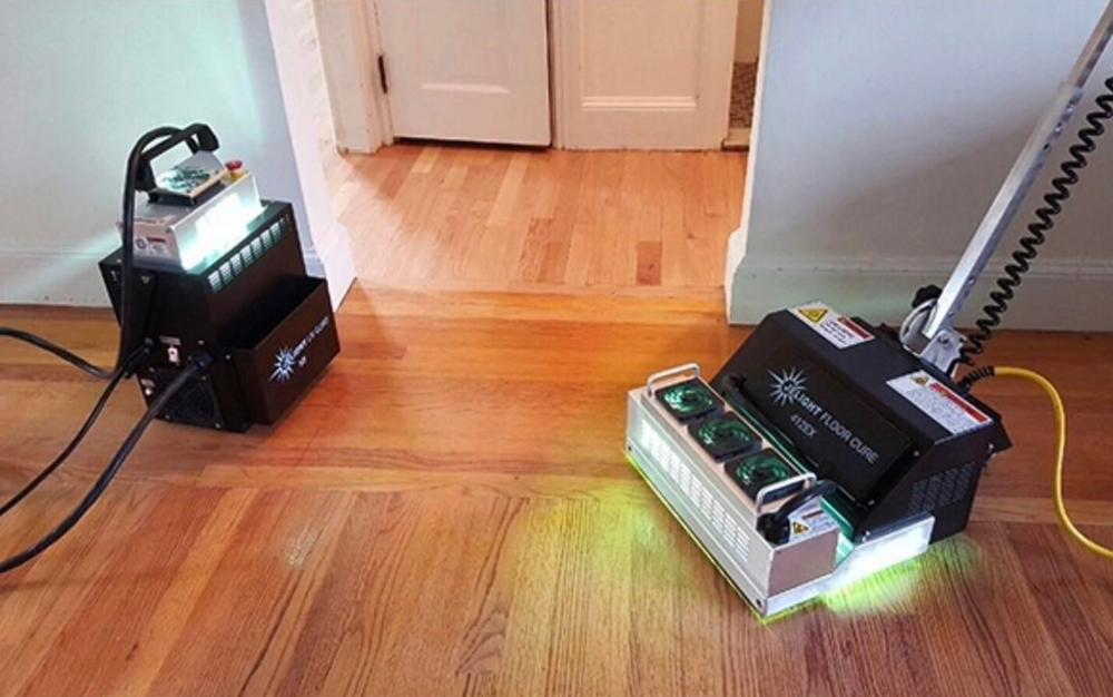 Curing hardwood floor with UV Light